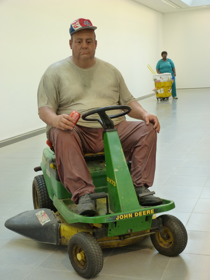 043  Duane Hanson   man on mower 1995 bronze  polychromed in oil .with  lawn mower