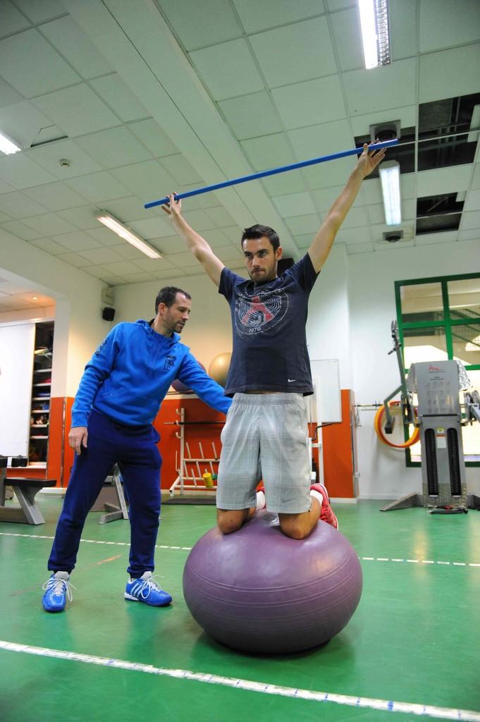 Quentin Halys dans l'ancien CNE fin 2014 avec son préparateur physique Sébastien Poublet.