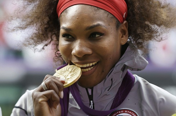 FILE - This Aug. 4, 2012 file photo shows Serena Williams posed with her 2012 Summer Olympics gold medal during the medal ceremony for women's singles tennis at the 2012 Olympics in London. Serena Williams will be competing in Rio. (AP Photo/Elise Amendola, File)/NY185/16197604546416/AUG. 4, 2012 FILE PHOTO/1607151905