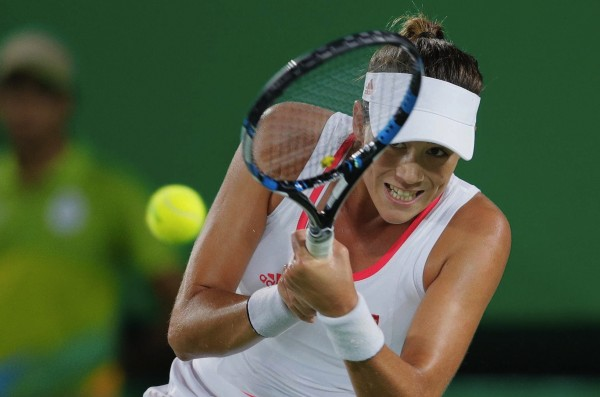 Spain's Garbine Muguruza returns a ball to Romania's Andreea Mitu in the women's tennis competition at the 2016 Summer Olympics in Rio de Janeiro, Brazil, Sunday, Aug. 7, 2016. (AP Photo/Vadim Ghirda)/OVG167/507c1f59a07648a38b21297d66fb0a91-d84728d135e240719d/1608080342