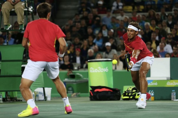 Mandatory Credit: Photo by Cristiano Andujar/AGIF/REX/Shutterstock (5828124gx) Brazil - Rio de Janeiro - 12/08/2016 - OLYMPIC GAMES 2016 - Marc Lopez / Rafael Nadal (ESP) plays against Florin Mergea / Horia Tecau (ROU), in Centre Court of Olympic Tennis Centre, Mens Doubles Finals of Summer Olympic Games. Photo: Cristiano Andujar/AGIF Rio 2016 Olympic Games, Tennis, Olympic Tennis Centre, Brazil - 12 Aug 2016 /Rex_Rio_2016_Olympic_Games_Tennis_Olympic_Tennis_5828124GX//1608130114