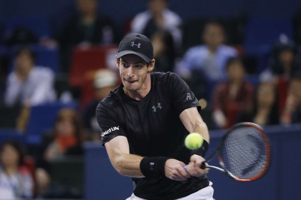 Andy Murray of Britain hits a return shot against Gilles Simon of France during the men's singles semifinals match of the Shanghai Masters tennis tournament at Qizhong Forest Sports City Tennis Center in Shanghai, China, Saturday, Oct. 15, 2016. (AP Photo/Andy Wong)/XAW150/16289624313242/1610151925