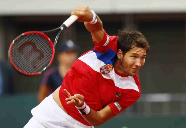 Serbia's Dusan Lajovic in action during his singles match against Great Britain's Kyle Edmund