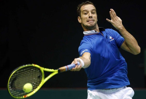 France's Richard Gasquet returns the ball to Croatia's Borna Coric during the Davis Cup semifinal tennis match between Croatia and France, in Zadar, Croatia, Friday, Sept. 16, 2016. (AP Photo/Darko Bandic)/XDB116/16260469513316/1609161507