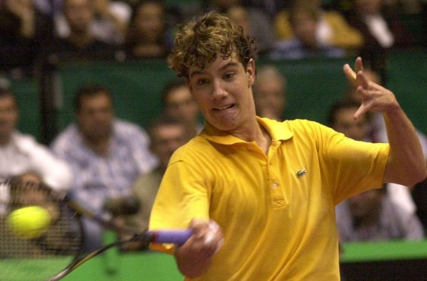 France's Richard Gasquet hits a forehand to Marat Safin of Russia Tuesday Oct. 8, 2002 during their match at the Lyon indoor tournament, central France, Tuesday Oct. 8, 2002.(AP Photo/Patrick Gardin)/0210082014